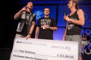 Vick receiving a check for hundreds of thousands of dollars from Empower Network